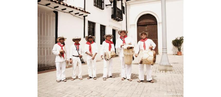 "The traditional Colombian Band ""Los Gaiteros de San Jacinto"" with their traditional drums and the Gaita (Third left to right)"
