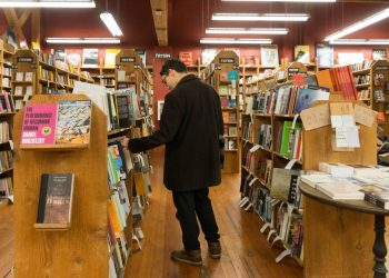Man in bookstore